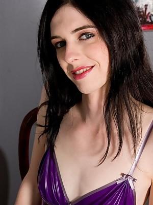 Filthy Mandy posing in hot purple latex dress